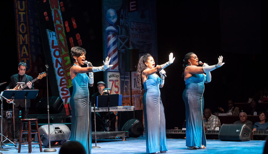 Motown singers perform on stage