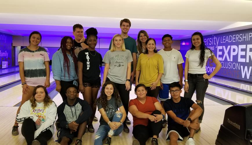 Olé students and advisors enjoy bowling night at the Hawk's Nest.