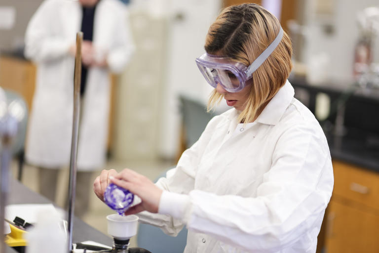 Girl working on a chemistry project