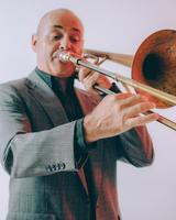 Image of Mr. Burge playing a trombone.
