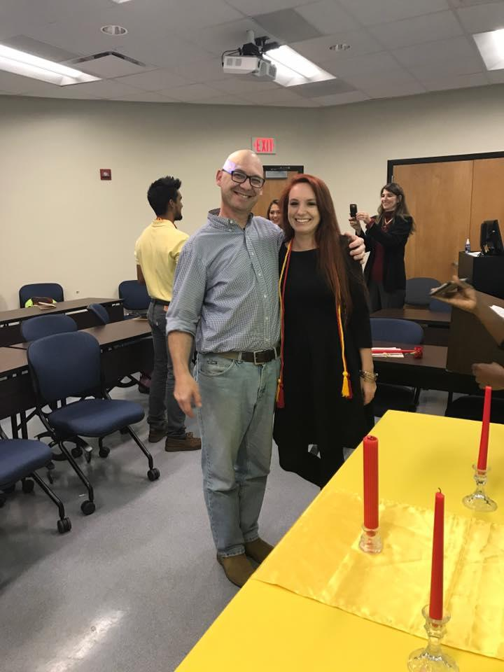 Dr. Enrique Porrúa poses with new Sigma Delta Pi inductee Kayla Lane.