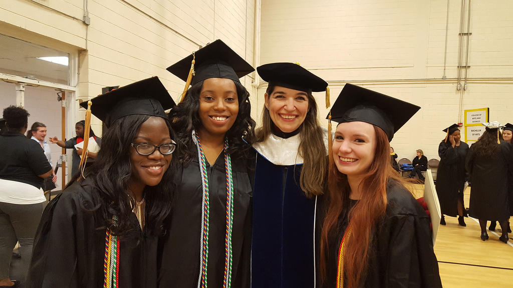 Julia Harmon, Tanisha Lassiter, and Kayla Lane pose for a picture with Dr. Cecilia Lara, director of the Foreign Language Program.