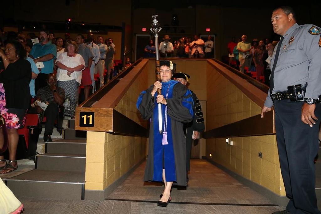 Dr. Beasley Carries the University Mace