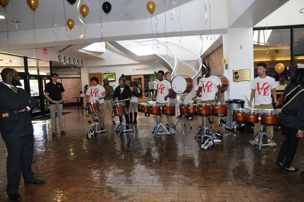 Students playing drums