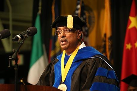 Siva Mandjiny delivering commencement address