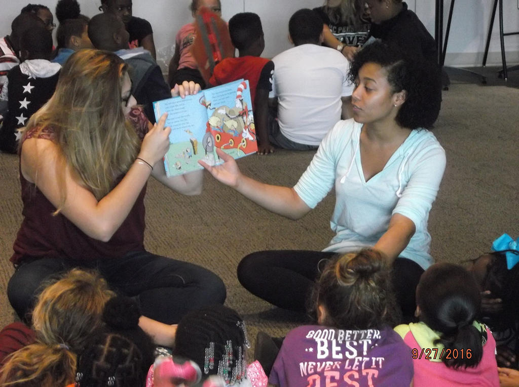 As part of a service learning project for an English 1050 class, students read Dr. Seuss to local elementary school children.