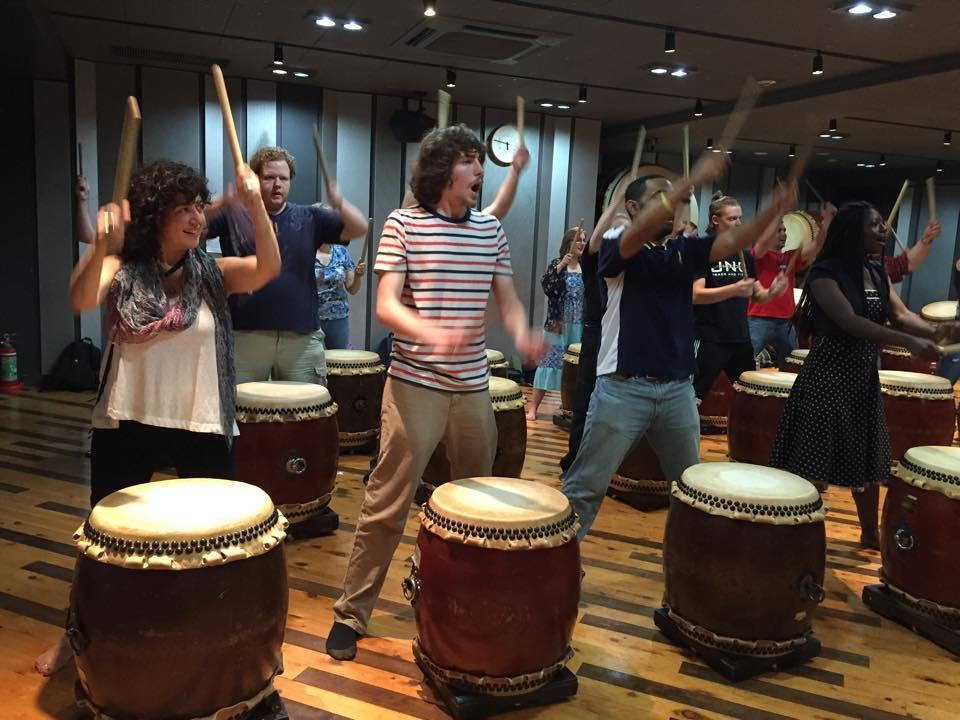 Dr. Michele Fazio and UNCP students participating in a wadaiko (drum) lesson during a study abroad trip to Tokyo