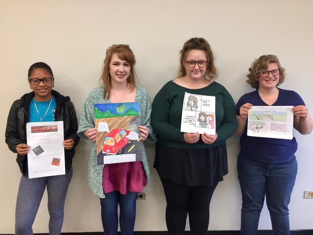 Students in Dr. Pitchford's Writing Creative Nonfiction I workshop display their graphic essay writing exercises