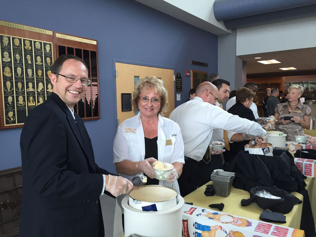 Dr. Scott Hicks, in his role as faculty senate chair, serves ice cream at a staff appreciation event