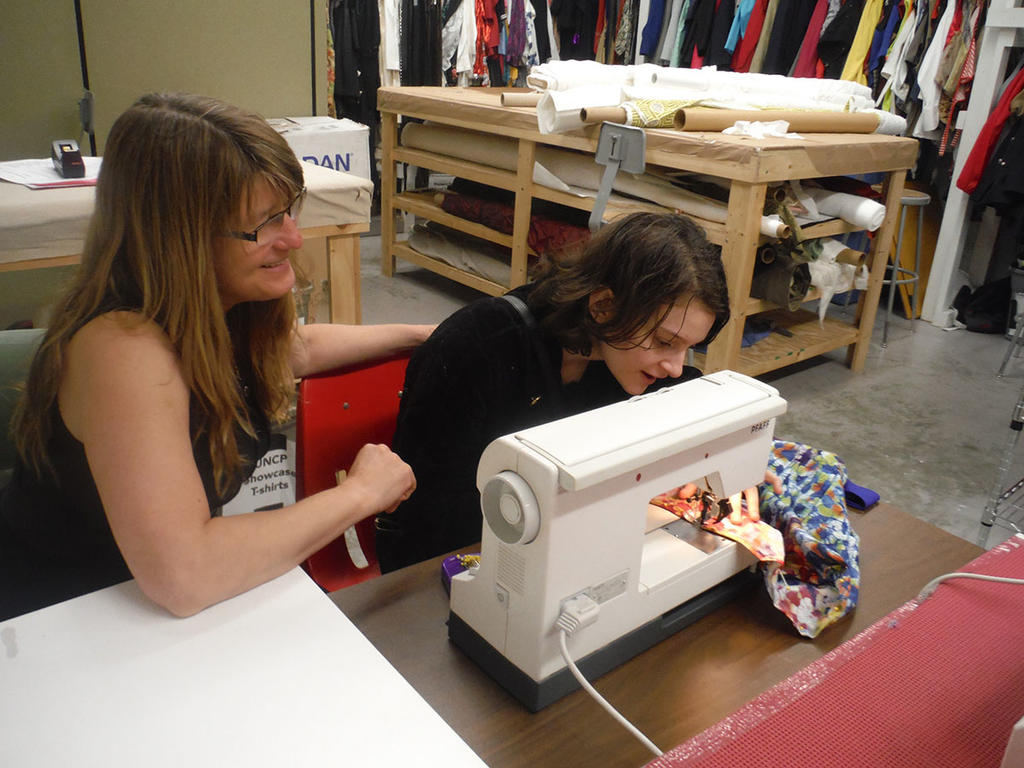 Stephanie Peters (left) helping one of her students in the Costume Technology course
