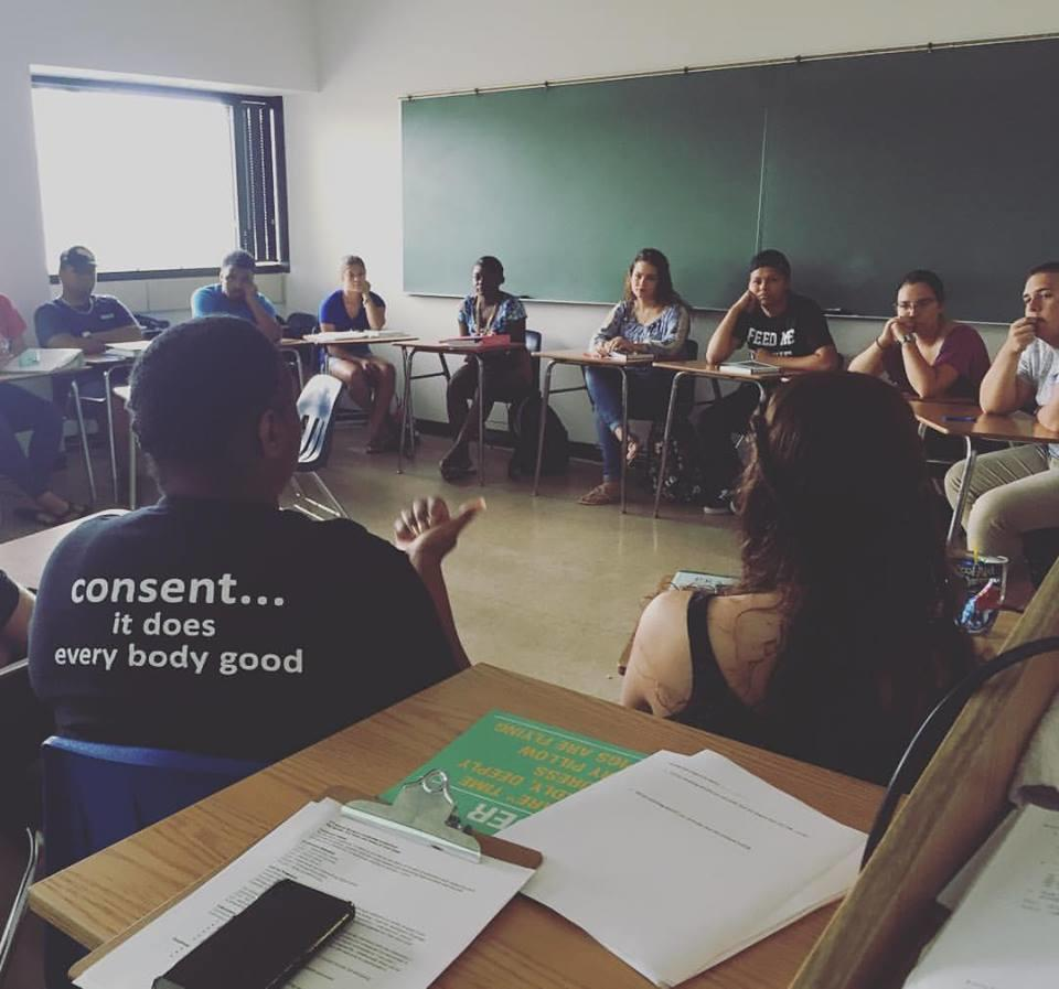 Students in a service learning 1050 English Class listen to a speaker from the Rape Crisis Center about relevant issues and concerns
