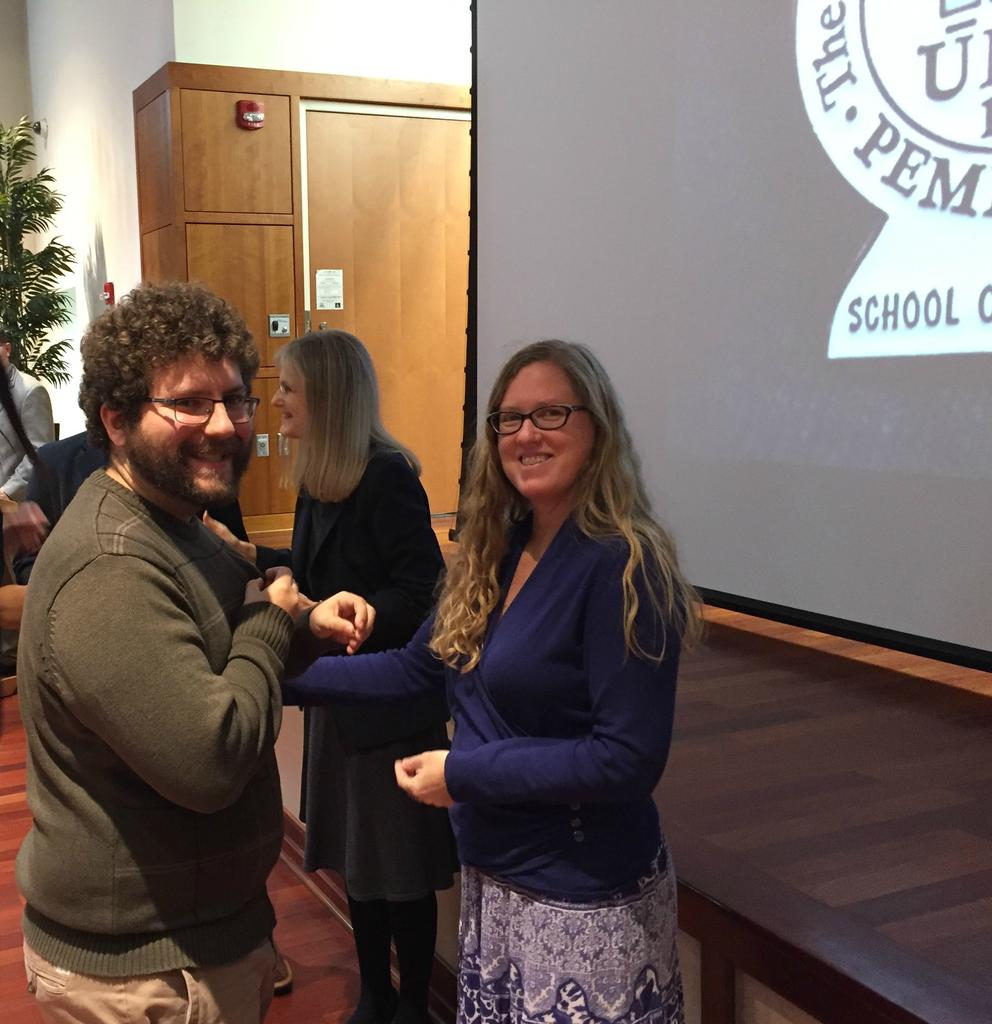 English Education major Joshua Dorman receives his pin from English Education Coordinator Denise Feikema.