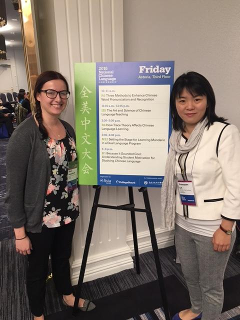 "Dana Reijerkerk, along with her Chinese Instructor Yuanyuan Lin, stand by their poster presentation, ""How Trace Theory Affects Chinese Language Learning,"""