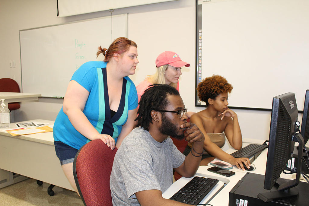 Ashley Self, Lauren Edwards, Terry Moore, and Amber Lawrence review the final draft of _ReVisions_