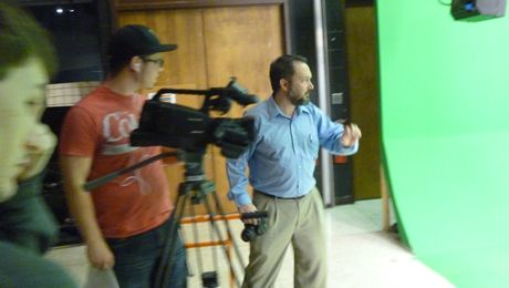 Dr. Jason Hutchens directs talent and crew on the greenscreen set.