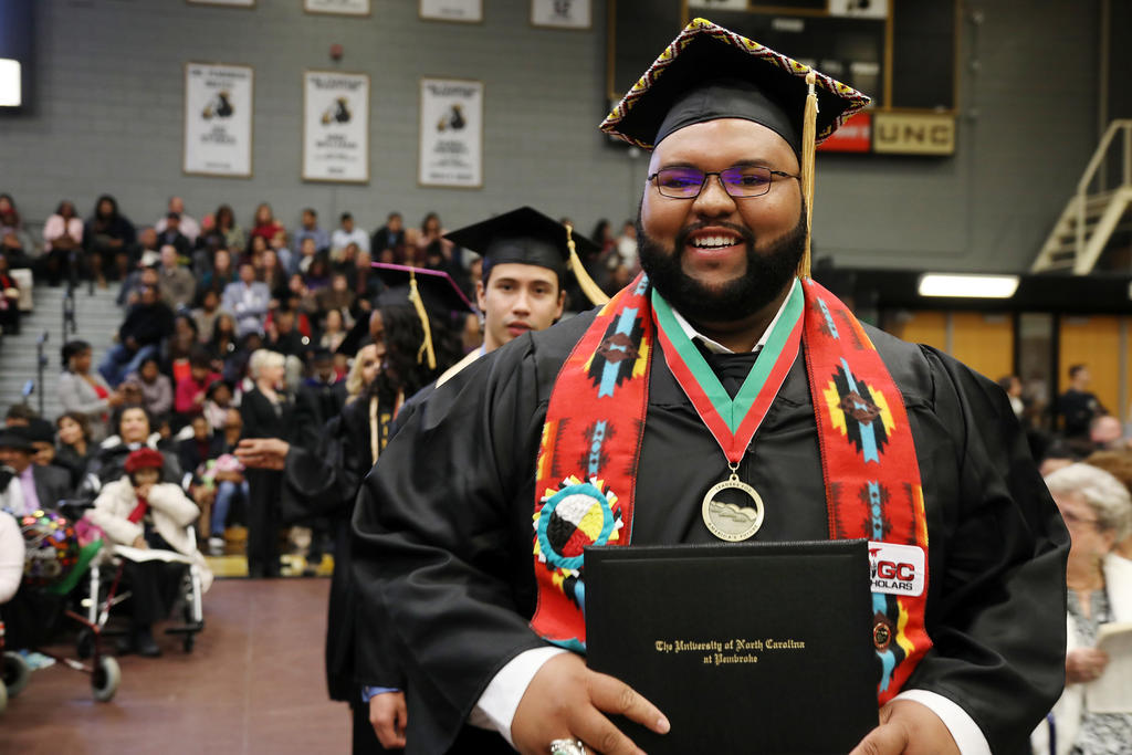 Harvey Maynor is all smiles after receiving his degree at UNCP on Saturday.