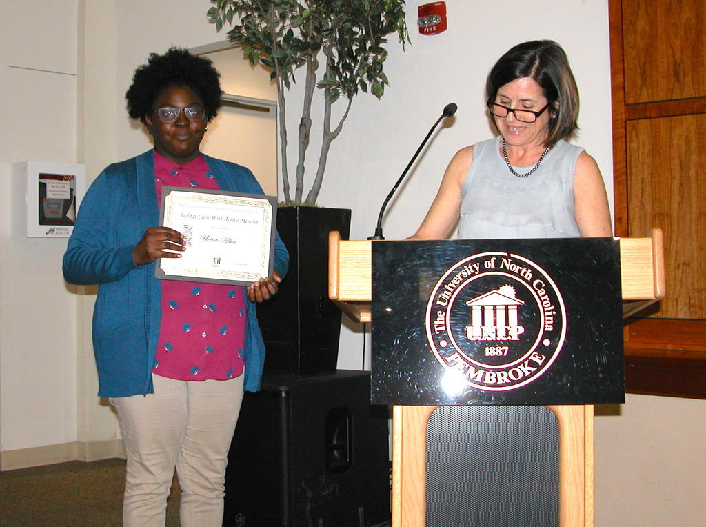 Uvina Allen receiving the Biology Club Award from Dr. Maria Santisteban