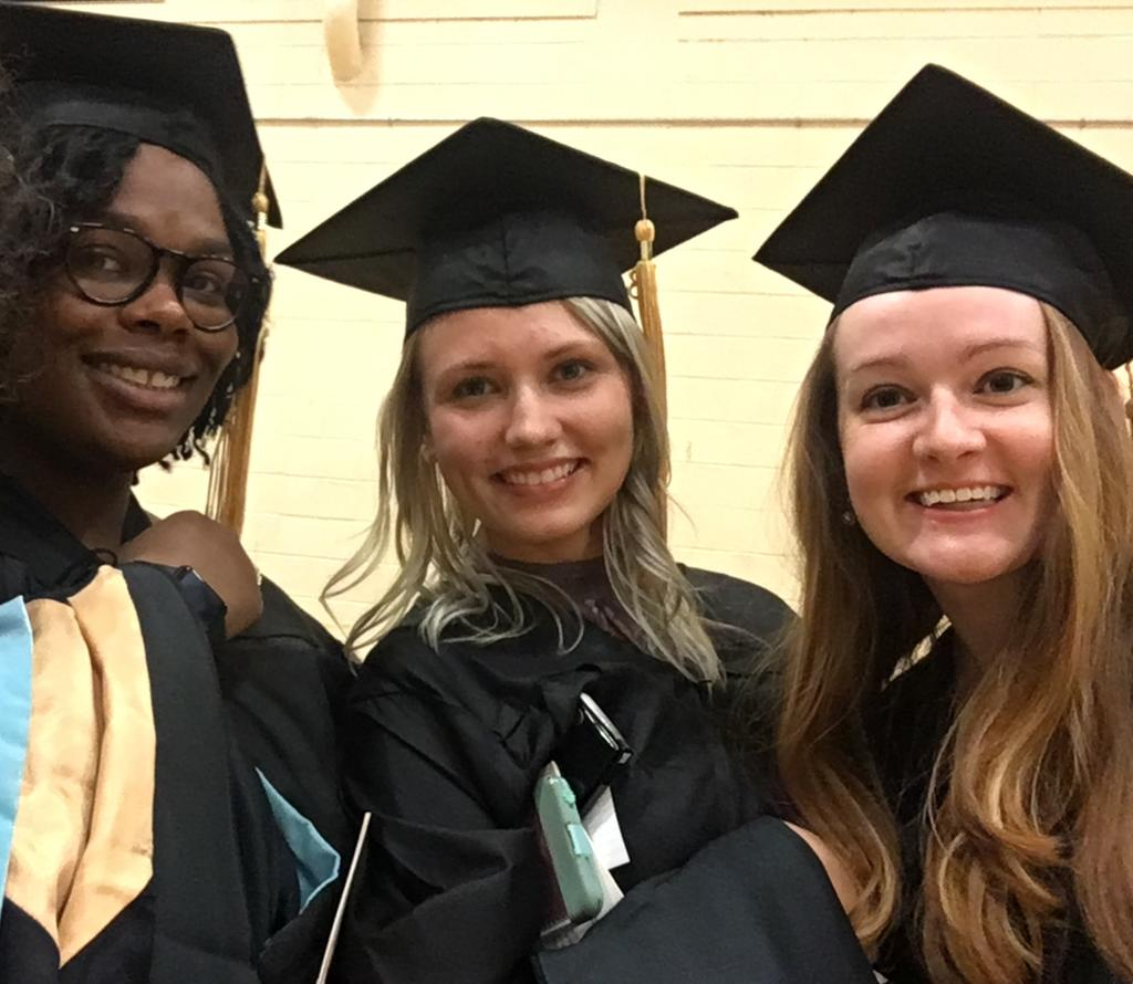 Spring 2018 master's degree recipients Asia Muhammas, Amber Hester and Brittani Allen pose for a picture. Photo Credit: Michele Fazio.