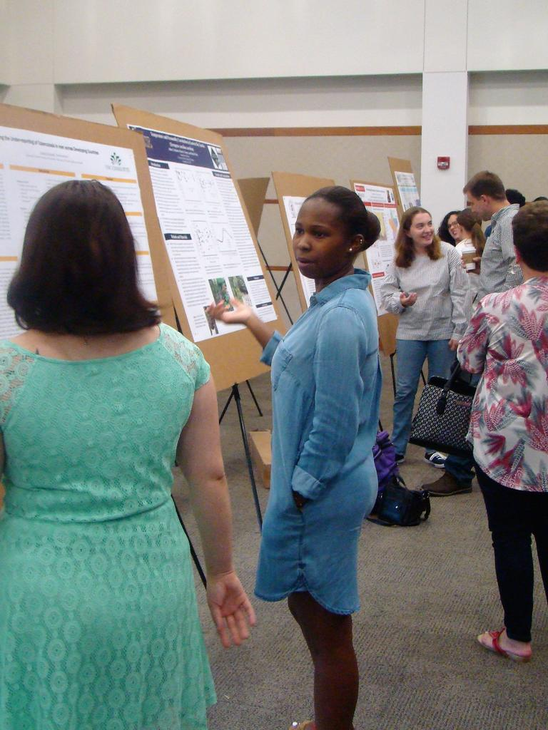 Ayanna Edwards and other students presenting and discussing their posters