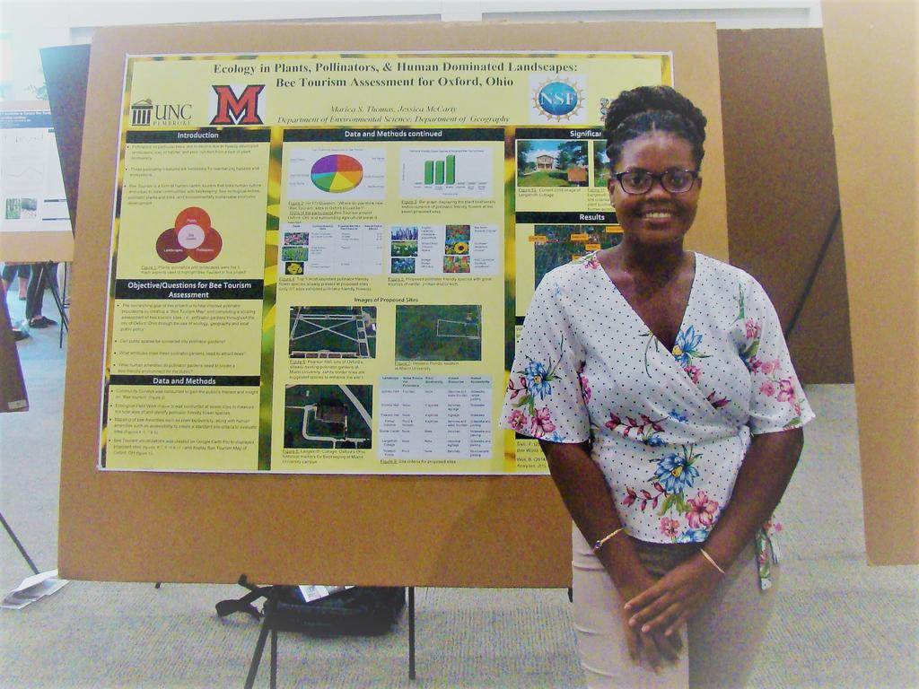 Marica Thomas standing in front of her poster