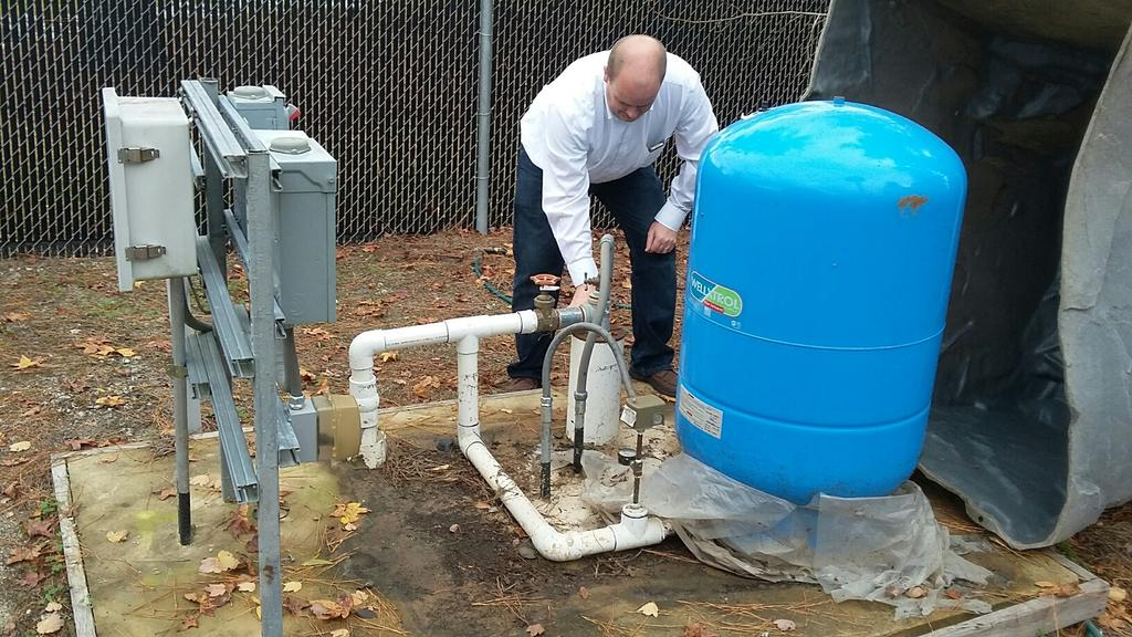Dr Nelson at one of the off-campus wells for the Groundwater Project