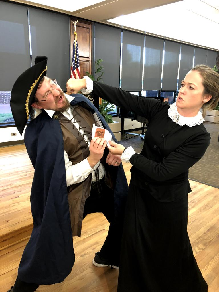 Professor Autumn Lauzon, dressed as Charlotte Perkins Gilman, knocks out Dr. Michael Berntsen, dressed as Thomas Paine, on Dead Authors Night 2018.