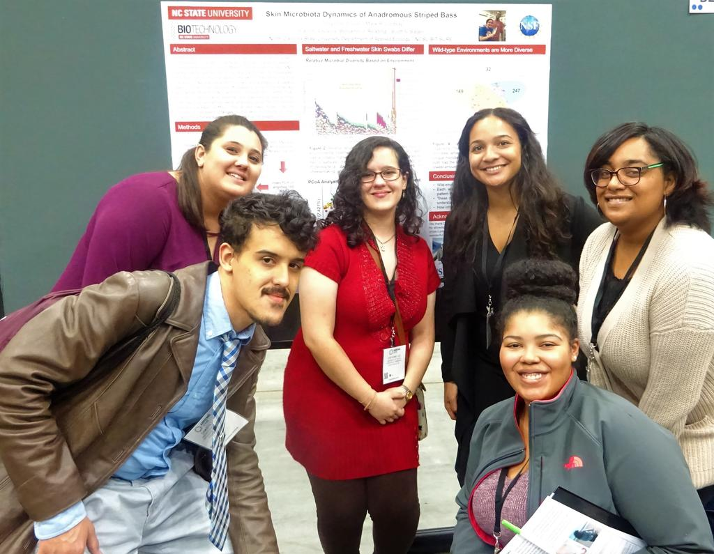Group picture of Kaitlan Smith, Cheyenne Lee, Victoria Spencer, Erica Baynard, Dakota Lee, and Jasmine Kelly at the grad school fair.