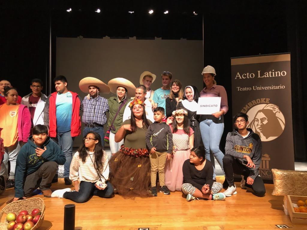Acto Latino students pose for pictures at Clinton High School after a performance of La Quinta Temporada on November 8, 2018.