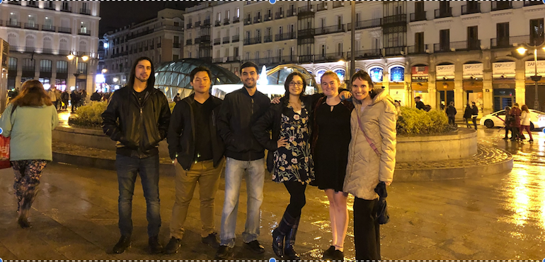 Dr. Lee poses for a picture with Foreign Languages Program students during an evening out in Spain.