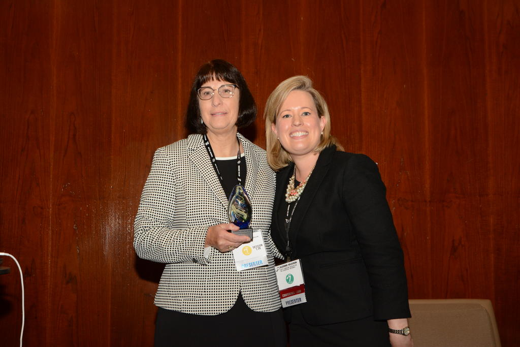 DR. RITA HAGEVIK (LEFT) RECEIVES THE 2018 DISTINGUISHED TEACHING AWARD IN STEM EDUCATION