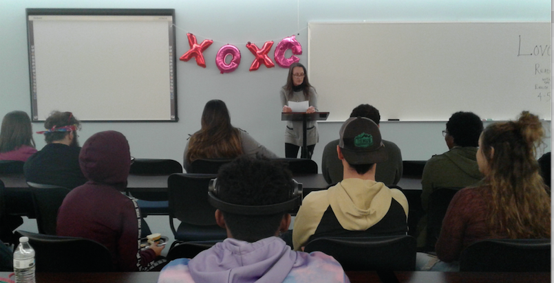 Dr. Cyndi Miecznikowski reads a poem at the Love/Hate Mic event on Feb. 13, 2019.