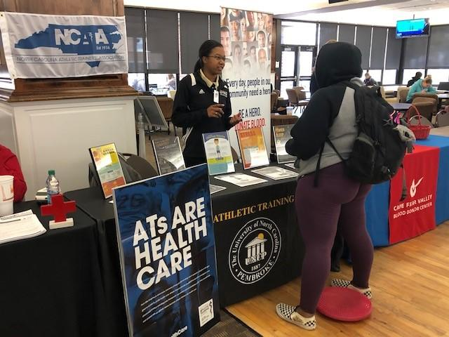 AT student educating students about athletic training.