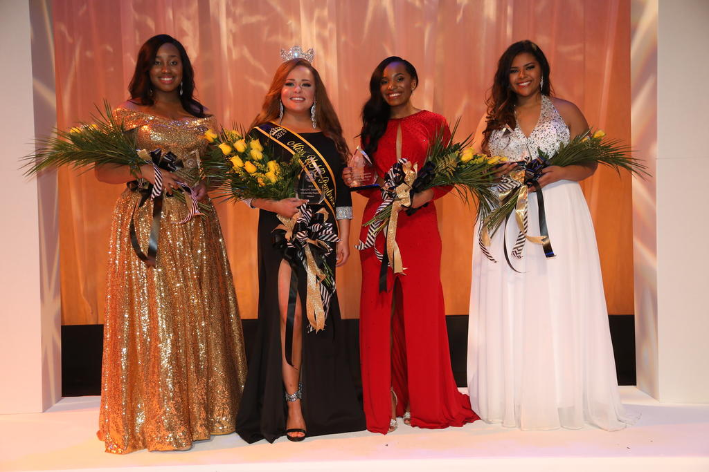 Alaina (second from left) poses with the winning court KaylaVera McBride (far left), Omega Cogdell and Anna Campbell