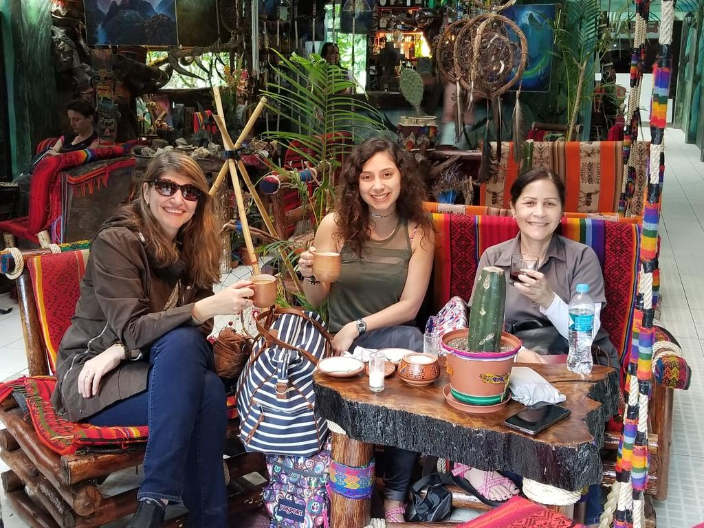 Foreign Languages Program faculty Dr. Ana Cecilia Lara (left) and Professor Milagros López-Fred (right) enjoy a beverage with student Sarah Rodriguez (center) during a spring break trip to Peru.