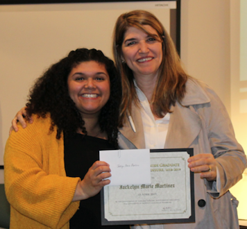 Dr. Ana Cecilia Lara (right) congratulates Jackelyn Martinez, recipient of the 2019 Outstanding Senior in Spanish Education award. Photo courtesy of Professor Sara Oswald.