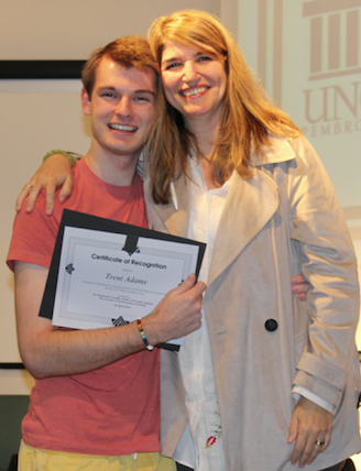 Dr. Ana Cecilia Lara (right) congratulates Trent Adams, the 2019 recipient of the Beatrice Locklear Brayboy Endowed Scholarship. Photo courtesy of Professor Sara Oswald.
