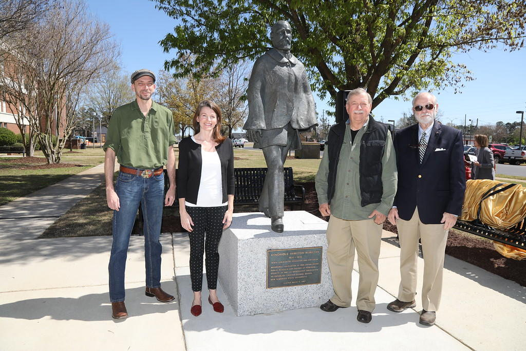 Art Department faculty Austin Sheppard, Carla Rokes (right), original sculptor, Professor Emeritus Paul Van Zandt and E.H. Alexander, great-grandson of Hamilton McMillan