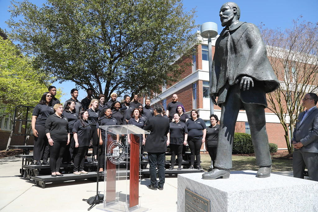 Pembroke Singers, led by Dr. Jose Rivera, perform at the Hamilton McMillan re-dedication ceremony on March 28, 2019
