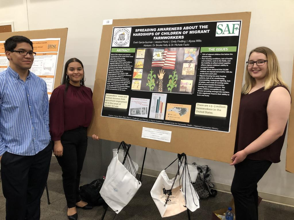 Emily Findling, Jessica Muniz, and Evert Garcia-Guzman shown during their poster presentation at the 2019 PURC Symposium