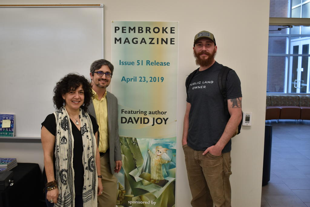 English Department faculty Dr. Michele Fazio (left) and Peter Grimes are shown with best-selling author David Joy during the Pembroke Magazine 51st issue release party