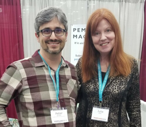 Dr. Peter Grimes (left) poses with Dr. Julie Kane at the 2019 Association of Writers and Writing Programs Conference in Portland, Oregon.