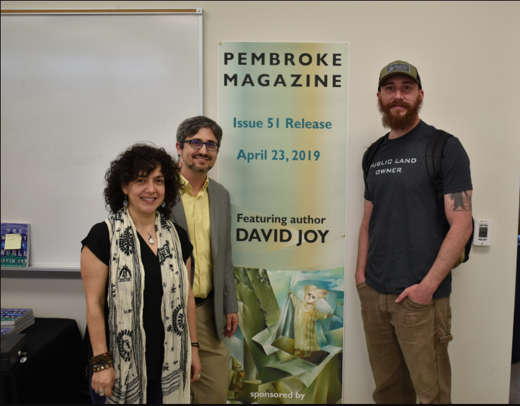 Dr. Michele Fazio (left) and Peter Grimes are shown with best-selling author David Joy (right) during the Pembroke Magazine 51st issue release party.