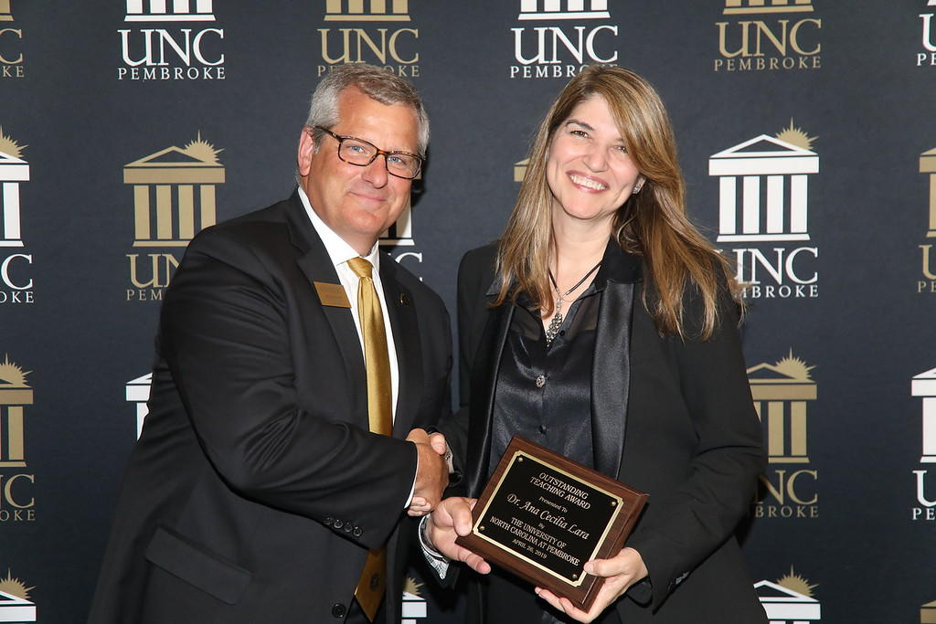 Provost Dr. David Ward congratulates Dr. Ana Cecilia Lara for earning the Outstanding Teacher Award at the 2019 Faculty Appreciation Dinner.