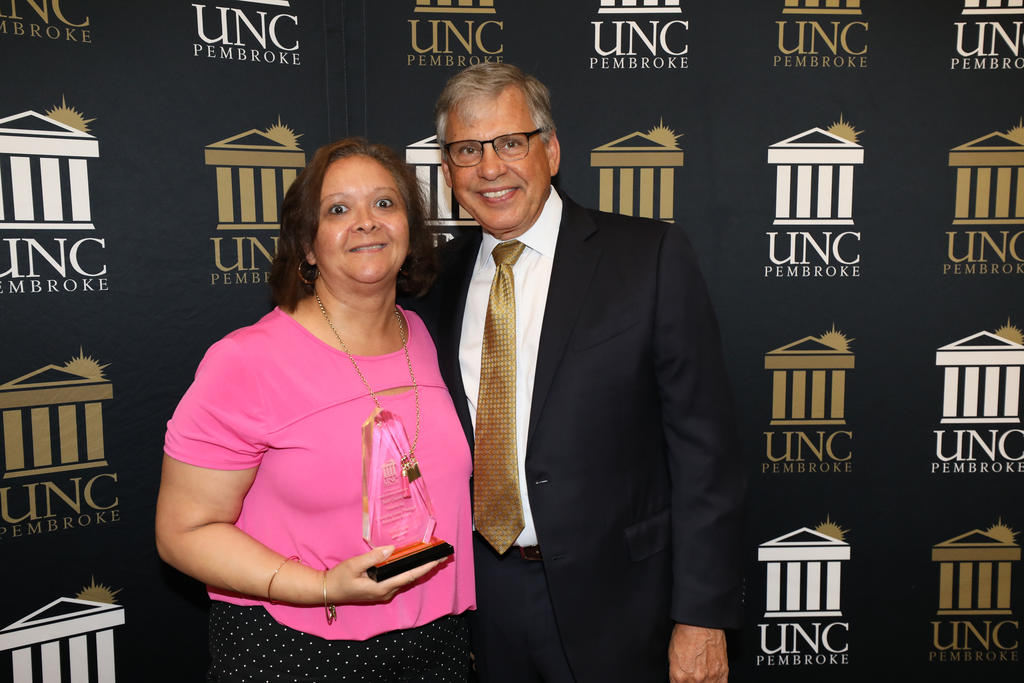 Chancellor Robin Gary Cummings presents Kim Hunt with the Changing Lives Through Education Award at the Staff Awards Ceremony on June 6, 2019