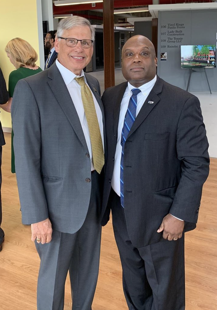 NC Public Safety Secretary Erik Hooks, right, met with Chancellor Robin Gary Cummings on July 24 after presenting the university with a grant to purchase public safety equipment