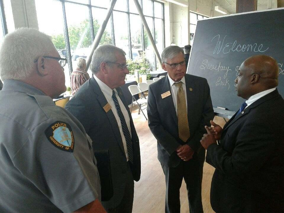 Secretary Hooks chats with UNCP Police and Public Safety Chief  McDuffie Cummings Jr., Provost David Ward and Chancellor Robin Gary Cummings at the Thomas Entrepreneurship Hub