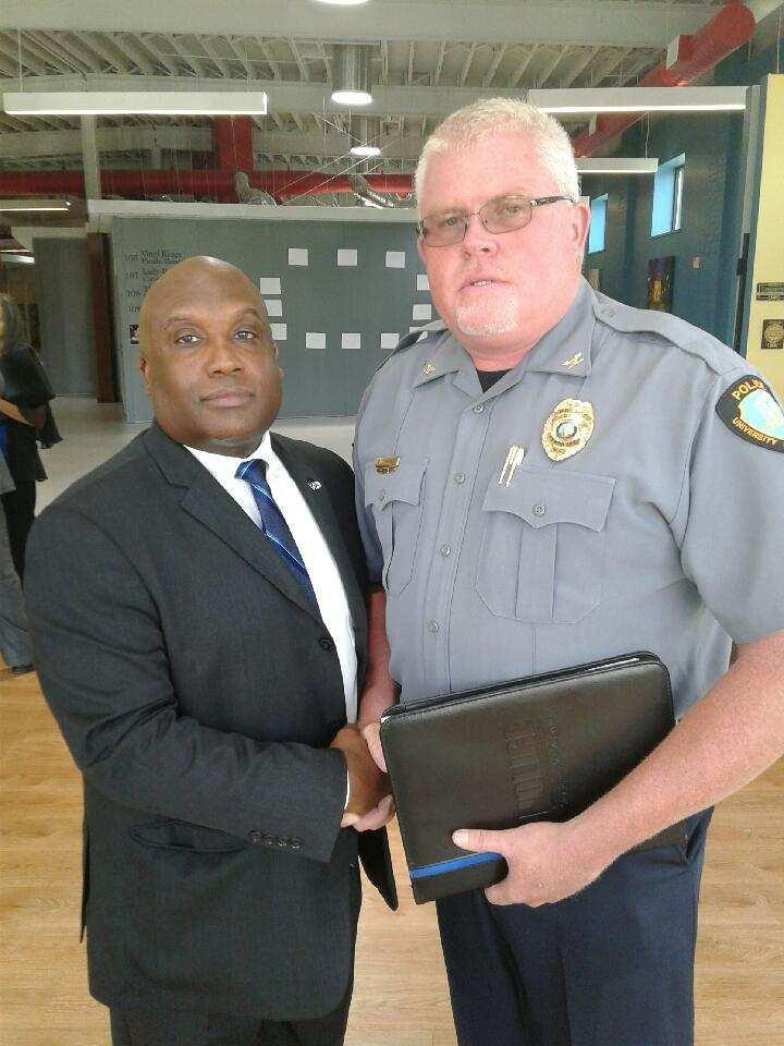 Public Safety Secretary Erik Hooks greets UNCP Police and Public Safety Chief McDuffie Cummings Jr. at the Thomas Entrepreneurship Hub