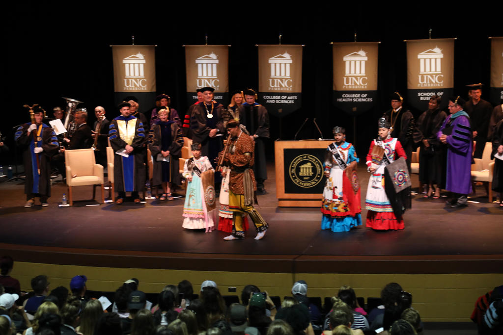 Flutist John Oxendine and the Lumbee Ambassadors lead the recessional at the 2019 First-Year Student Convocation at Givens Performing Arts Center on Aug. 12, 2019