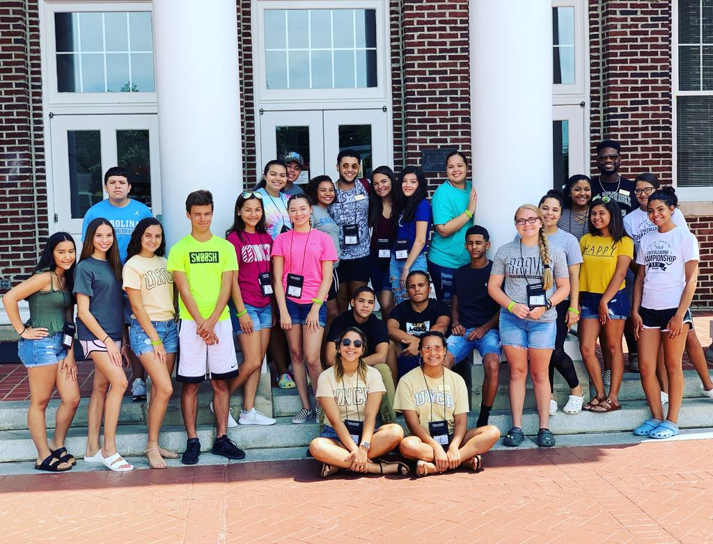 Project ACCESS summer camp youth pose in front of Old Main