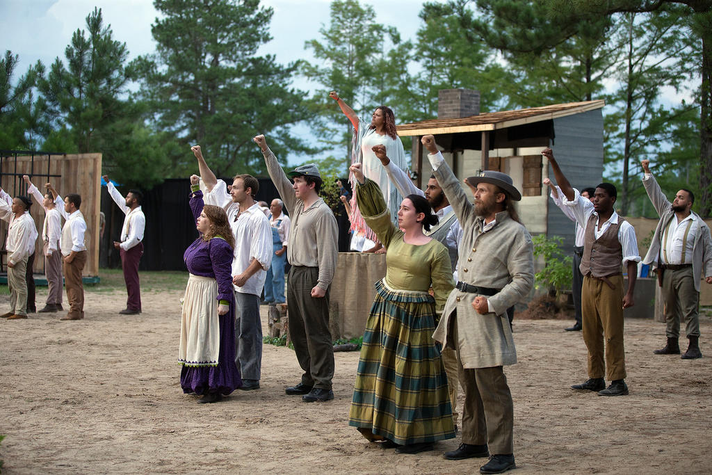 Actors perform a scene from Strike at the Wind! at the Lumbee Tribe Cultural Center